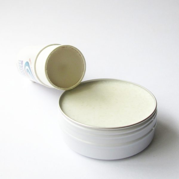 Deodorant stick and tin open so you can see product inside