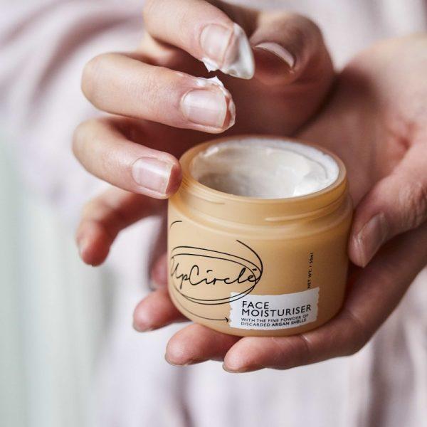 Face moisturiser in hands