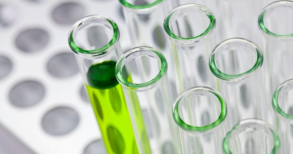 test tubes with green liquid